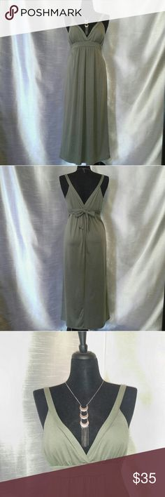 Gorgeous Maxi Dress w/Plunging Neck & Back (EUC) This stunning light olive green Maxi dress, w/ a deep plunging neck & back is sure to stop people in their tracks! This dress got me so many compliments, as it's flattering in many different ways! The high empire waist is great for covering up any hangups you might have, which was my FAVE part about it! The material is very breathable, so it's great for the Spring/Summer! Dress it up or down, so it can be worn for many different occasions! No…