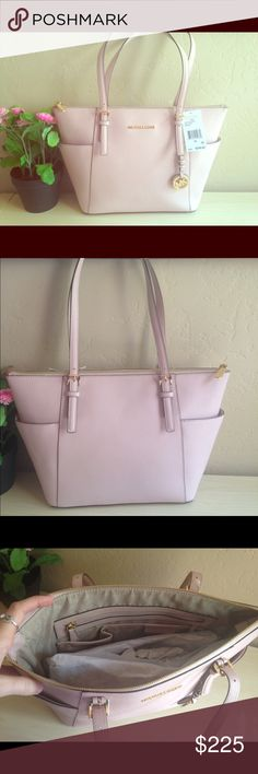 """Light pink Michael Kors Jet Set Tote NWT MK Purse. Never been used! Had been sitting in my closet, not my color or style that I love. Have so many other purses! The authenticity card is missing but this is 100% authentic. The tag also shows color """"black"""" was a manufacture defect in the printing. Was purchased by my husband from MK store in SD. Pictures to show the tag and the serial # inside the purse. I moved and this was boxed up, sent across the states with me. It's in pristine condition…"""