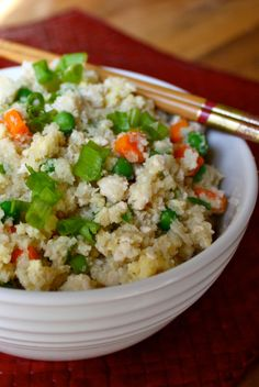 "Swap out rice and replace it with cauliflower in this low-cal version of fried ""rice"" that's packed with veggies. Get a boost of protein with ground chicken or chicken breast. This cauliflower fried rice recipe makes servings for a whole week, so it's perfect for meal prep! // beachbody // beachbody blog"