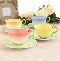 Beautiful tea cups, each tea cup in a lovely pastel color, pink, yellow and blue. Tea Party anyone?