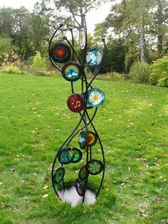 metal and glass!  beautiful www.glassdesignsuk.com Peace Garden Sculpture
