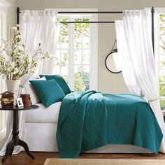 Like the color combination, but not the way the teal color was used. The teal coverlet and pillows make the bed look visually heavy in an other wise light and airy room. Teal accents such as vases or small picture frames would have been better.