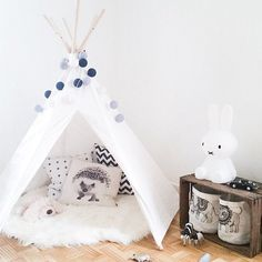 Sweet black and white tipi corner reading NOOK
