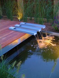 Steel waterfeature in decking by Guy wolfs