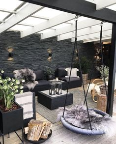In love with this industrial warehouse-style room! The swing seat is the finishing touch!