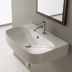 """Modern style Moon 27.6"""" Wall Mount Bathroom.The sink is made of high-quality ceramic in a white finish. Perfect for modern bathrooms."""