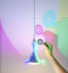 The CMYK bulb by Dennis Parren combines a white main light source with coloured LEDs in red, green and blue to cast shadows in cyan, magenta and yellow
