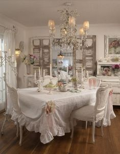 "[   ""Vintage dining room Love"",   ""Rachel ashwell shabby chic dining room great for a tea party!!"",   ""romantic shabby chic.. Shabby Chic exquisite pink lace coverlet..shabby chic! Shabby Dining"",   ""shabby white cottage style dining room chandelier"",   ""I"