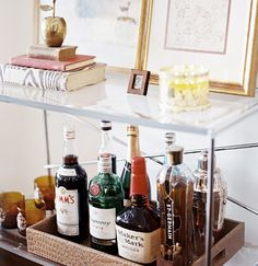 Make Mine a Double: Bar Cart Fantastic. Is it just me or is there a bar cart at every turn these days? I love the look of bar carts - like a . Home Bar Sets, Bar Set Up, Bar Cart Styling, Bar Cart Decor, Mini Bars, Bandeja Bar, Bar Deco, Small Bars For Home, Gold Bar Cart