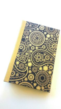 Check out this item in my Etsy shop https://www.etsy.com/listing/271039952/navy-and-gold-paisley-junk-journal