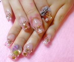 That's some very awesome 3D nail art, but what is that pink stuff on the middle finger?