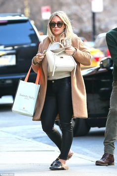 Designer buy:The 29-year-old actress looked chic in leather jeans, a beige sweater, a lon...