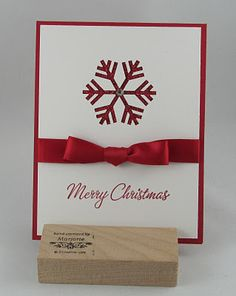 CAS snowflake card:  Stamp - Four the Holidays  Ink - Real Red Classic Ink  Card Stock - Real Red, Whisper White, Red Glimmer  Other - Snowflake Punch, Real Red Satin Ribbon    - bjl
