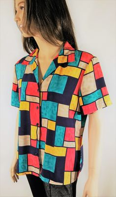 5f4e4769a1247 Vintage 80 s Women s Short Sleeve Colorful Geo ColorBlock Top Shirt Blouse  by NOTATIONS Size L Petite