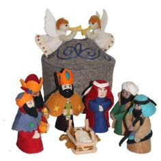 Magical Felt Nativity Set Gray - Silk Road Bazaar (O) All figures in this nativity are handcrafted in felt. The set includes 3 Wise Men, Mary, Joseph, Baby Jesus in a manger, 1 Shepherd, and 2 Angels affixed to the stable roof. The 8-inch diameter stable stores the figures or is a perfect backdrop for the nativity scene. Average height of figures is 5 inches.