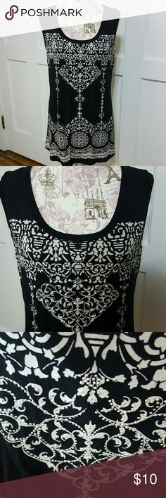 "B.L.E.U.  Top New Condition  Black with white pattern  Silver tone Shiny Embellishments in center Lace on top back Arm Pit to Arm Pit lying to 18"" Length 29"" 95% Rayon. 5% Spandex  Hand wash B.L.E.U Tops Tank Tops"