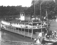 The Steamer 'Rowena' on the Cumberland River in Burnside, Kentucky. Burnside was a center for shipping by rail and steamboat packet. Its lumber mills sent products around the world.