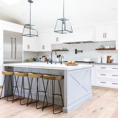 Looking for Modern Kitchen ideas? Browse Modern Kitchen images for decor, layout, furniture, and storage inspiration from HGTV. Modern Farmhouse Decor, Modern Farmhouse Kitchens, Home Kitchens, Industrial Farmhouse, Modern Industrial, Kitchen Modern, Blue Kitchen Island, Kitchen Island With Seating, Gray Island