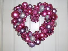 valentine's wreath...stock up on Christmas ornaments when the stores mark them down to make wreaths for every holiday... Valentine's pinks, red, purple.. St Patty's green & gold... etc etc