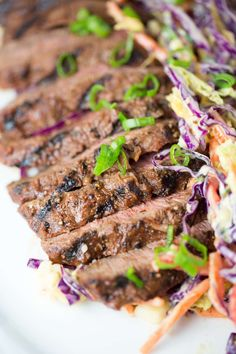 Marinated Grilled Flat Iron Steak - Earthy spice blend of garlic, onion, smoked paprika, and generous amounts of kosher salt and pepper. Delicious recipe served with coleslaw | jessicagavin.com