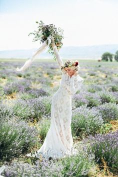 Bohemian long sleeve lace modest wedding dress with lovely floral bouquet & head dress.