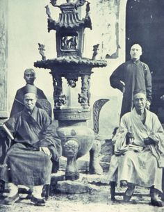 Taoist priests in front of temple on