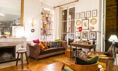 Very Parisian Studio Apartment: Glazed Doors, Marble Table, Candles, Fireplaces, Paintings, Massive Chandelier, Threadbare Parquetry and no Closets
