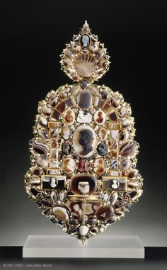This sconce, purchased by Louis XIV in 1684 from the dealer Le Brun, features a multitude of stones and cameos. The stones are set off by a metalwork mount in the style of Pierre Delabarre, a 17th-century goldsmith, ca. 1630.