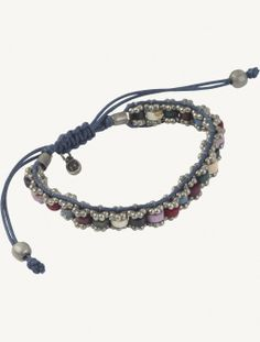 Love the daisy beads and ceramic washers on this wrap bracelet