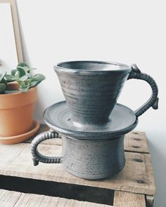 I'm absolutely in love with this handmade coffee dripper (think beehouse or Chemex) and mug set. The Simple Cup partnered with a potter who makes the most fantastic and unique pieces.  #pottery #handmade #happiness #mug #simple #coffee #dripper #beehouse #thesimplecup #mornings #gray