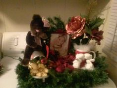 Lighted centerpiece with teddy bear photo frame and 2 angels kissing and more. maid to last $40.00 shipping and handling not inciuded