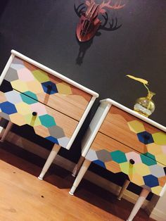 'Number 22' matching pair of 1950s dual drawer Bedside tables. Casing and squat legs in semi gloss white enamel. Honeycomb Geometric pattern to all drawer fronts hand painted and sealed. New black metal barrel knobs applied.