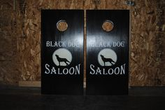 Black Dog Saloon in Missouri.  This custom cornhole game board set was hand painted with lights.  Each bag sets comes with (bags), and drink holders