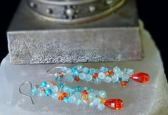 Colorful Orange Zirconia with Aqua Chalcedony Apatite Turquoise Long Gemstone Cluster Earrings Gift for Her Bright Mexican fire opal cubic zirconia step faceted briolettes shine brightly beneath dozens faceted aqua chalcedony, turquoise and smooth polished neon apatite rondelles.