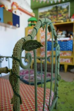 crochet vine-covered bed - perfect for a children's room. Today's crochet in the home pic is a quirky little decorating idea.