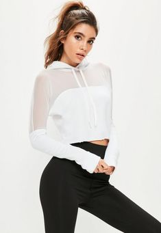 7ff38034f6 Hit the gym in style with this white crop hoodie with mesh panel. Sportos  Outfitek
