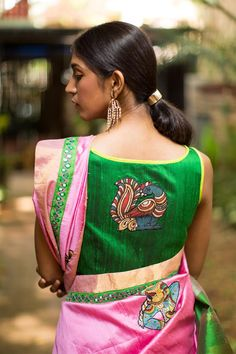 Simply chic! A simple boatneck blouse in green raw silk with bright green detailing and a kalamkari appliquéd on the back. Just a dream come true this one…Take a cue from us and see the myriad ways this beauty can be paired. Pair with 'any' saree with a touch of green in it and you'll be the ruling stylista!FABRIC:Body – Green raw silkDetail – Kalamkari applique on the back and lime green raw silk neck