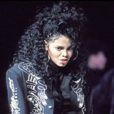 Janet Jackson's best hairstyles over the years including her amazing curls. | essence.com
