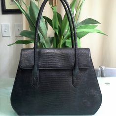 DONNA KAREN rare vintage bag Its a classic big bag. 3 big compartments inside . 1 small zipped pocket . Reptile leather look but basically it's embossed leather. Outer condition is excellent but inner shows sign of wear. But still nothing major. I tried to you show in 3 rd picture. Its made in Italy.  Originally very expensive. Donna Karan Bags Shoulder Bags