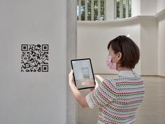 Scanning the QR codes in the pavilion allows visitors to watch films including Interrail 2038, which features two 18-year-olds in a peaceful future world. London Mosque, Venice Biennale, Digital Wall, Dezeen, Room Themes, Worlds Of Fun, Pavilion, Qr Codes, Im Not Perfect