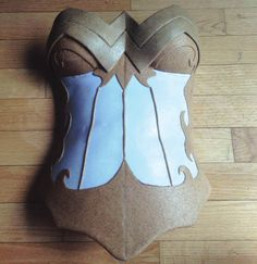 "DIY Wonder Woman Cosplay by Becka Noel. Step 6: To create breastplate cups, first I took two large squares (about 10""x10"") of Worbla & heated them together to make a double Unpainted Tiara - Two Viewslayer. Then, I took my half plaster sphere & carefully stretched the Worbla over it. Some people use acrylic spheres or Christmas ball ornaments for this step. Once half sphere Worbla pieces were made, I drew on my design and attached to the very large breastplate piece."
