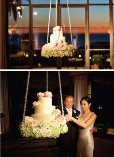 hanging wedding cake,, gorgeous, very unusual idea, I wonder if it swings??.