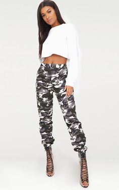 ImageGrey Camo Print Cargo Trousers ~ Featuring a neutral grey camo print material and a cargo fit, these trousers can be styled up or down. Team them with some lace up heeled boots and a knotted front crop top for a killer look. Grey Camo Pants, Camo Pants Outfit, Camo Dress, Camo Joggers, Trousers Women, Pants For Women, Clothes For Women, Women's Trousers, Printed Trousers