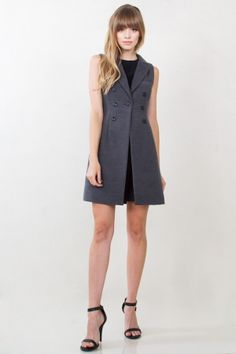 Caryn Vest Dress. Sleeveless collared jacket that can also double as a dress. Single button closure.
