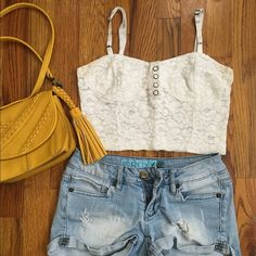 F21 White Lace Crop Bustier Perfect for spring and summer! Adjustable straps. Buttons on front (don't actually unbutton). Good condition. Well loved but still has a lot of life left in it! Make me an offer! Forever 21 Tops Crop Tops
