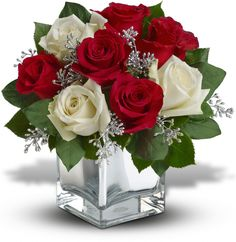 The perfect Christmas hostess gift, this exciting bouquet of red and white roses in a dazzling mirrored cube is guaranteed to make spirits brighter. Simple, stylish, affordable ¬ better order one for yourself as well.