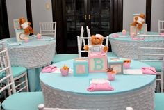 Baby Shower Centerpieces for Tables | were dressed in fitted white ruffled table toppers. The centerpieces ...