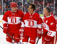 Detroit Red Wing  Viacheslav Fetisov talks with Chris Chelios and Paul Coffey chat on the ice.