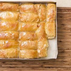 Holy hell… Galaktoboureko - Greek pastry of custard cream filled phyllo rolls, baked, then drenched in syrup, like Baklava. Greek Sweets, Greek Desserts, Greek Recipes, Phyllo Recipes, Cooking Recipes, Greek Cookies, Greek Pastries, Greek Dishes, Mediterranean Recipes