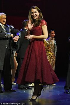 The royal was given the gift on stage by co-producer Lord Michael Grade following the performance of the Broadway hit at the Theatre Royal Drury Lane where she was greeted by a host of VIP guests as well as people benefiting from EACH